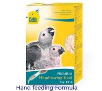 Cede premium hand nearing food for birds