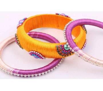 Yellow color silk thread bangles set