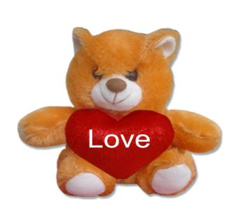 "Small cute teddy bear with red heart and the text ""Love"""