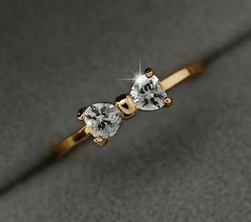 Bow shaped stone setting finger ring