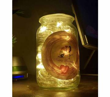 mason jar with decorative LED lamp