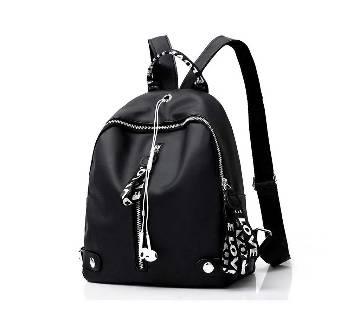 Black and white ribbon backpack